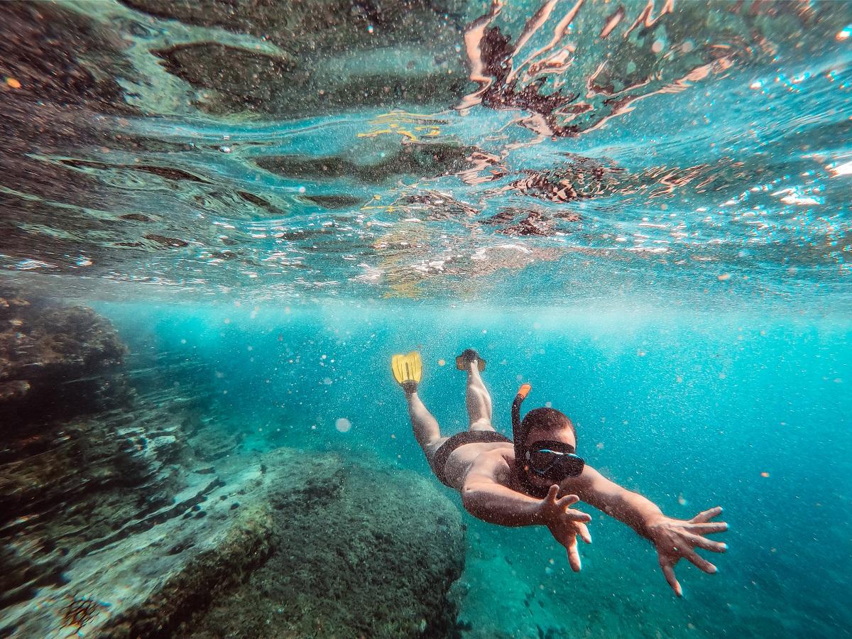 Underwater Photo Of Men Diver Snorkeling In The Sea