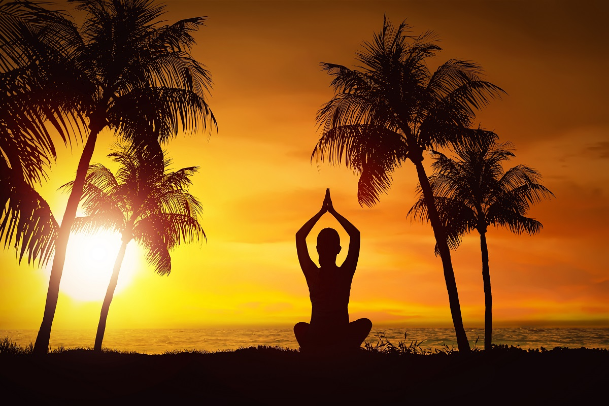 Silhouette Of Woman Doing Yoga With Ocean View