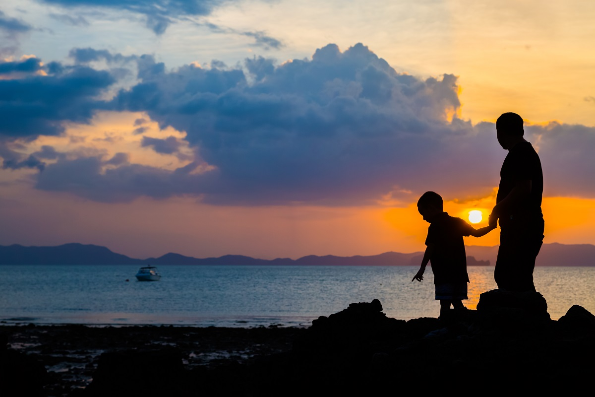 Silhouette Image Of Father And Son At The Beach
